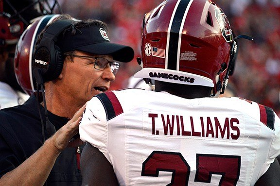 Coach Bobby Bentley with running back Ty'Son Williams.
