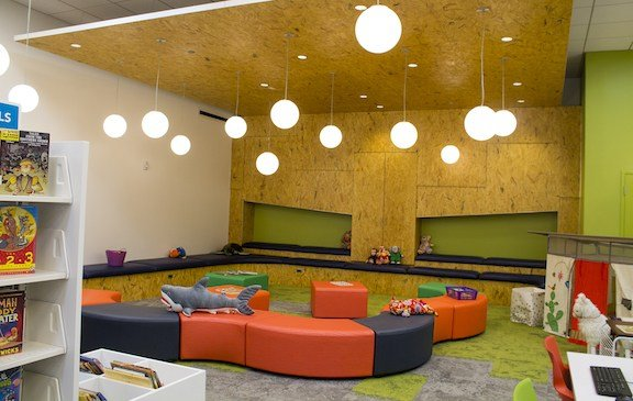 The children's area at the St. Andrews Library, filled with toys, seating and lots of play area for the kids.