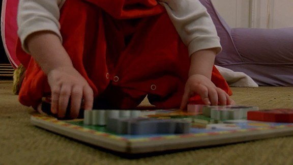 Doctors say hands-on learning and social interaction is better for children than learning from video screens.