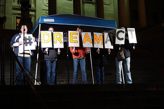 The speakers encouraged the crowd gathered at the State House to use their influence by spreading the word on social media about a clean Dream Act.