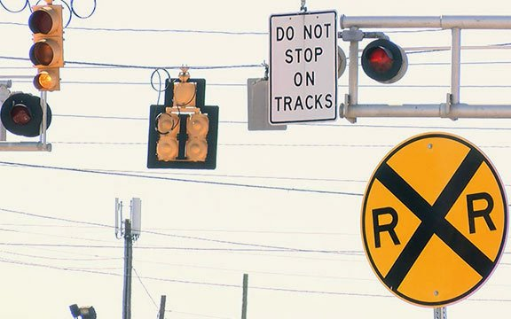 Railroad signs are placed around the tracks to alert drivers about the potential trains.