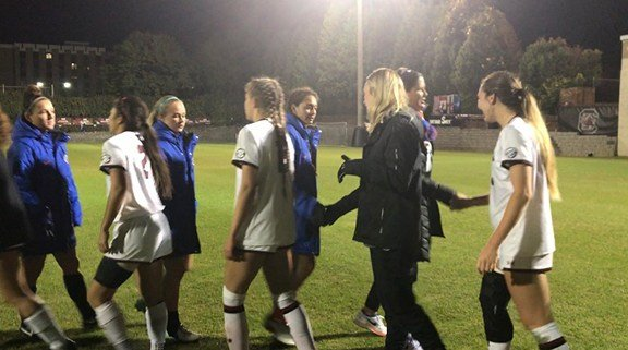 The women's soccer team shaking hands with Florida after their 2-0 win.