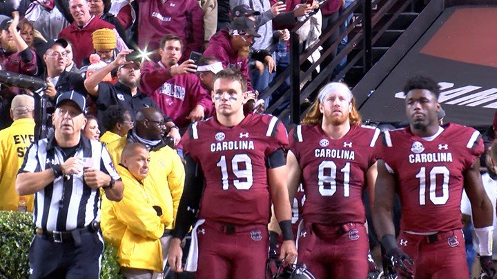 Saturday's captains entering the field before kickoff.