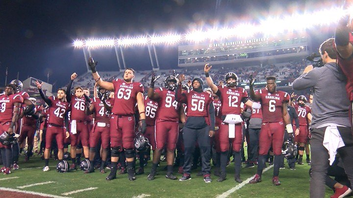 The football team singing the alma mater one final time at home this season.