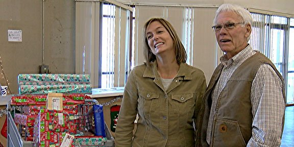 Neil Bonacum and Candice Escoe, father and daughter, sponsor a needy family for the first time and feel it's a special feeling to give to others as it brings everyone together.