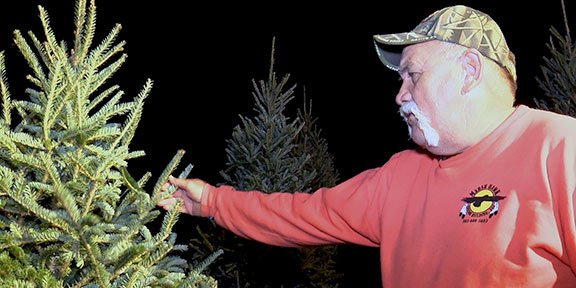 Bryan Price, owner of Price's Christmas Tree Farm in Lexington, says real Christmas trees make him feel better at work and at home.