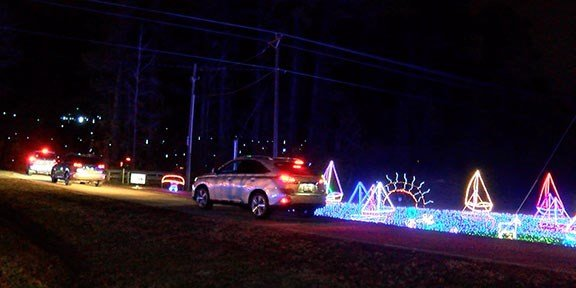 Visitors drive through a display of lights that show the different activities that happen on Lake Murray.