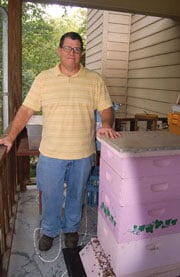 Tom Ballou keeps some of his hives on his front porch.