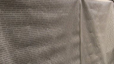 A wall with a list of the 2,975 names of those who died during the attacks on the world trade centers.