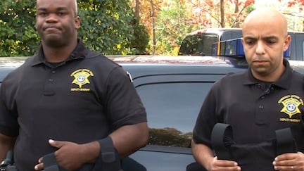 The two deputies that received the bullet proof vests posed for pictures outside of Cook's home Tuesday morning.