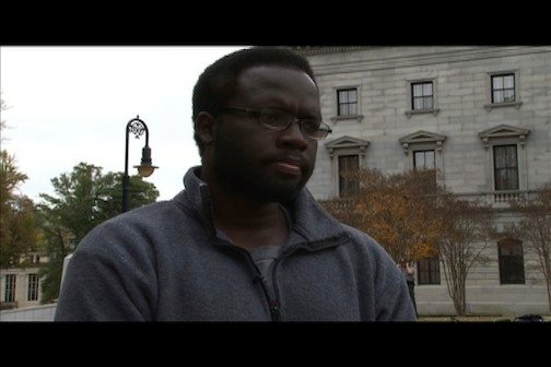 Occupy Columbia Protester Bradley Powell returns back to State House grounds after being arrested Wednesday night.