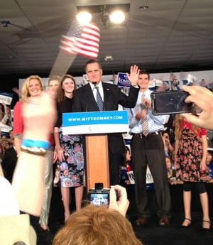 Mitt Romney waves to supporters at the fairground.