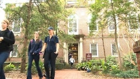 Students walking to and from class outside of Currell College a few's days after the fire occurred.