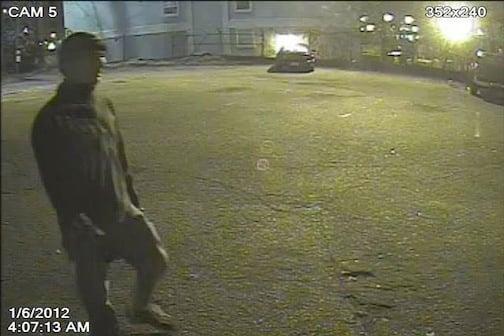 Still frame of arsonist from surveillance footage.