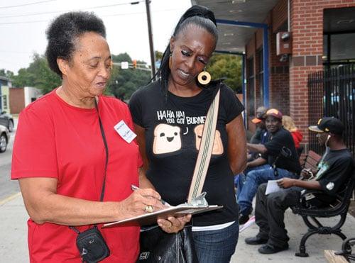 Virginia Sanders showed Evelyn Davis a voter registration form. Davis said she was registered but wanted to check on registering her mother.