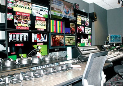 On gameday, 13 staffers from the control room inside Williams-Brice Stadium operate the ribbon boards and replay video of football plays, captured by one of the eight cameras around the stadium, on the scoreboard.