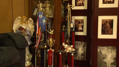 These are some of the trophies and ribbons that Travis has won for his performances in karate competitions.