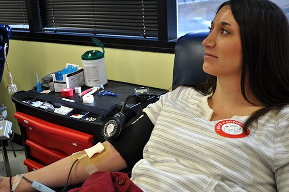 Layne Bee, a biology teacher at Spring Valley High School in Columbia, recovers in the donation chair at the Columbia American Red Cross after giving blood Monday afternoon.  Photo by Sarah Ellis