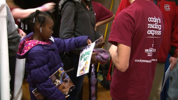 Books were given out to children in attendance.