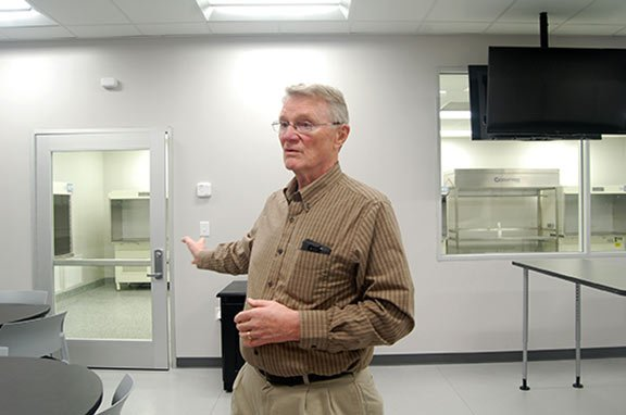 Fred Olafson, a lab instructor at the ACE Lab, speaks about the differences in air qualities between the classroom and lab room to keep the work area as sterile as possible.