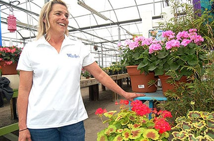 Robin Klein, general manager of Woodley's Gardening Center in Columbia, says to be careful not to fertilize your plants to early in the spring season. Photo by Harrison Cahill.