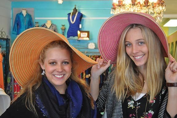 "LucyGordon Smith, left, and Karley Nyman, employees at Julia Neal Fashions in Five Points in Columbia, said that Carolina Cup fashion is becoming ""a lot less preppy"" and more ""bohemian chic."" Photo by Travis Broussard."