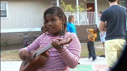 Dayshana lives at the family shelter and find joy by playing guitar