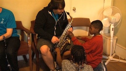 Children living at the shelter get the chance to learn musical instruments like the saxophone