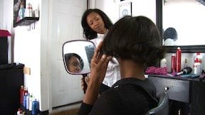 Natural Beauty Studio Owner Erica Ruth admiring her client's happiness after hair styling is complete.