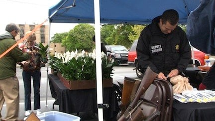 People received peace lilies after turning in guns.