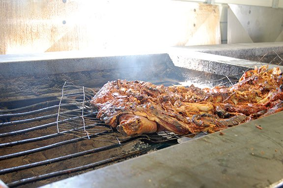 Rodney Scott, owner of Scott's Bar-B-Que in Hemingway, S.C., roasts his hogs over pit smokers.
