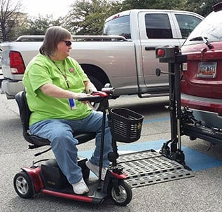 Cindy Amick uses a scooter to get around the University of South Carolina campus. Photo by Jay Michaels