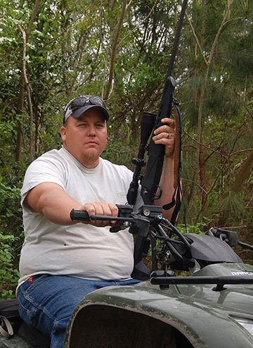 Poseskie says in order to avoid injury, he uses a gun to kill hogs over 300 pounds. Photo by Kyle Heck.