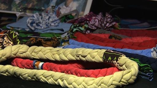 Knot bracelets Clothed In Hope instructors taught Zambian woman to make.