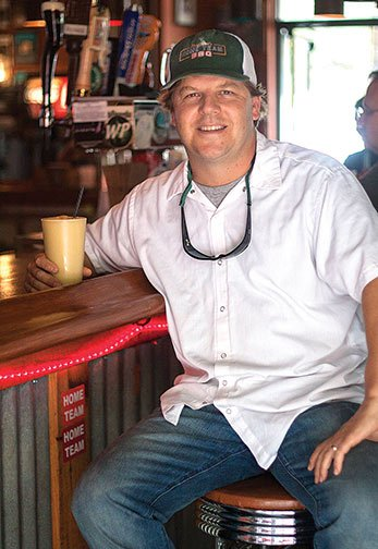 Aeron Siegel, owner of Home Team BBQ in Charleston, opened the restaurant in a renovated gas station in 2006 after years working in high-end cuisine.
