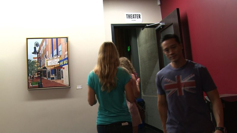 Moviegoers file into the theater to watch 'The Trip to Italy' an independent film showing at The Nickelodeon.