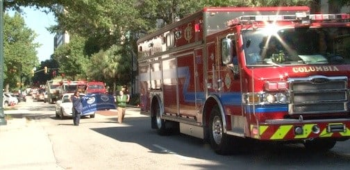 Emergency vehicles travel down Main Street as part of the annual parade.