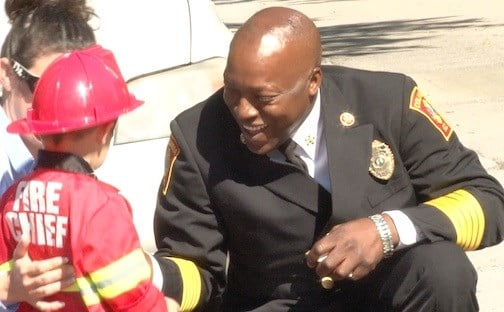 Columbia Fire Chief Aubrey Jenkins greets a parade-goer.