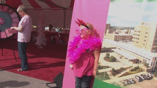 People of all ages come to the tent to learn about breast cancer awareness.