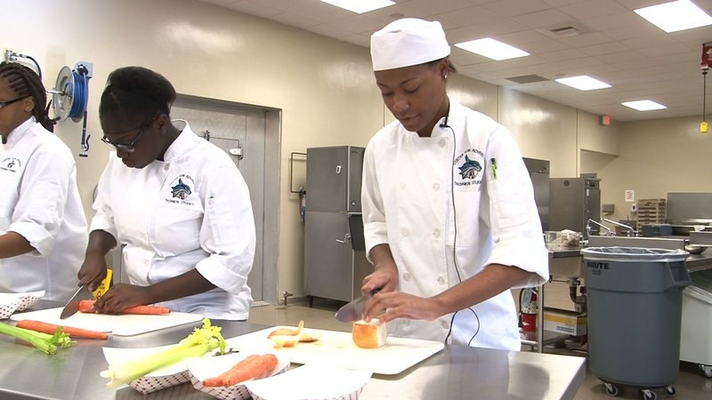 Darriene takes culinary arts class to perfect her skills.
