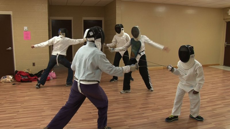 Ann Pringle Washington and her grandson practice fencing every week to keep their minds and body in shape.