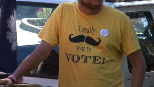 Protestors wore t-shirts to encourage voters as midterm elections approach
