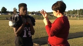 Kevi Hardin is a deaf football player, and Angie Shafer uses sign language to help him play football.