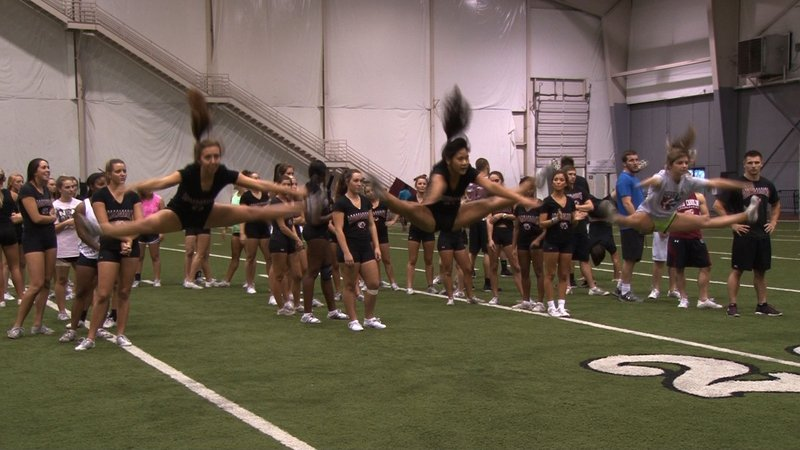 The cheerleaders practice over nine hours a week working on new skills.