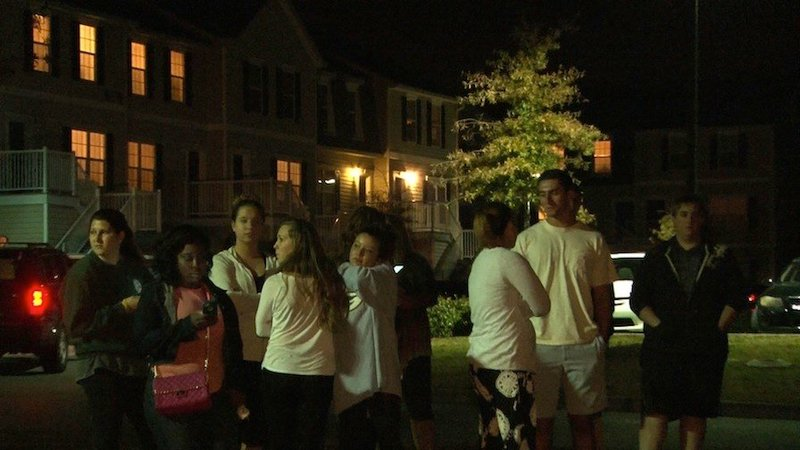 Residents gathered at the crime scene Tuesday night.