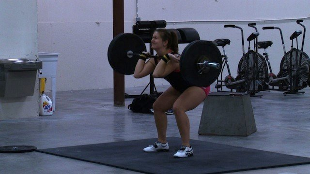 Crossfitters like Sarah Clinton perform exercises like power cleans as part of a W.O.D., or workout of the day.
