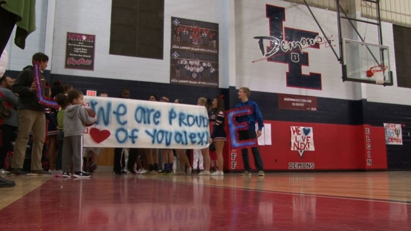 Cheerleaders and fans made a banner to show their pride in Alex Martin