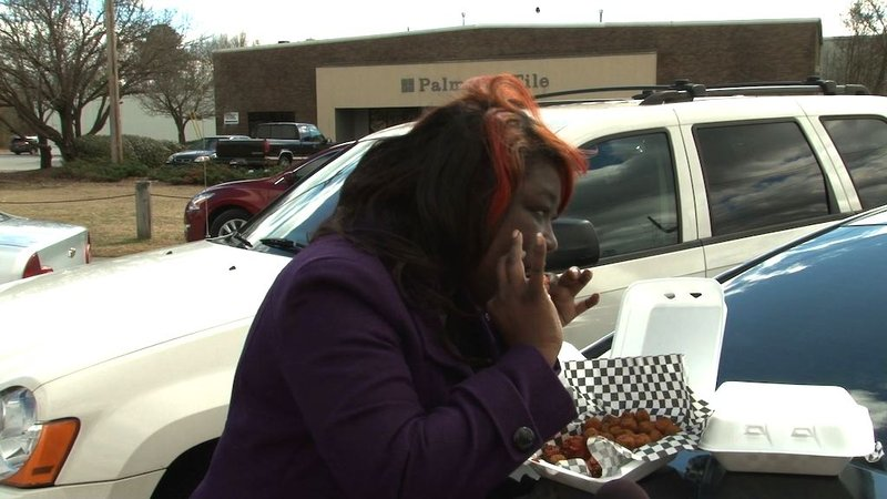 2 Fat 2 Fly customer Felicia Hollingsworth indulges in the unique and tasty wings.