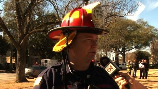 Fire Spokesman Brick Lewis shuts down block of Laurel Street because of hazardous chemicals