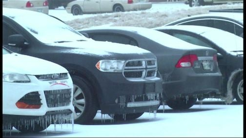 Cars and roads are covered with snow as winter storms enter the Carolinas